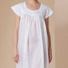 Woman in white cotton nightgown